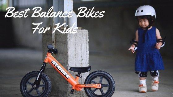 kid with a orange balance bike